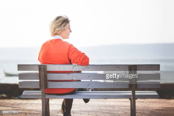 senior woman sitting alone - alzheimer's disease stock pictures, royalty-free photos & images