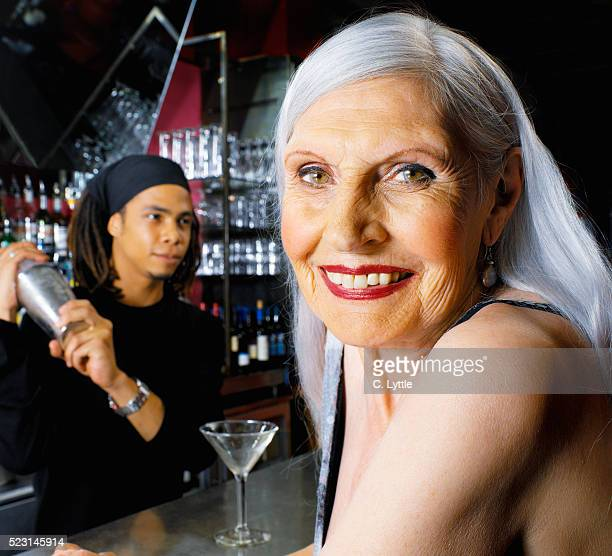 Senior Woman Sitting at Bar