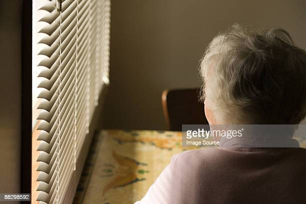 Senior woman sitting by window