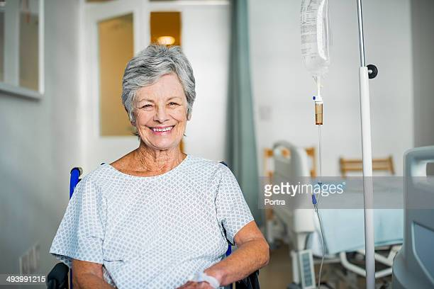 Senior woman sitting in a wheelchair in hospital