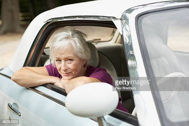 Senior woman sitting in car