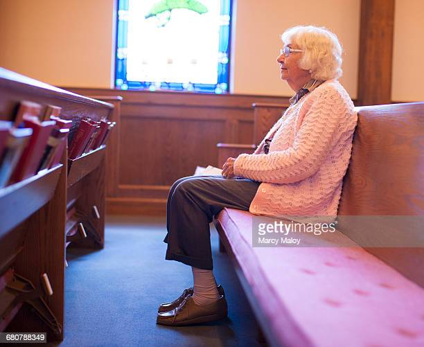 Senior woman sitting in chapel
