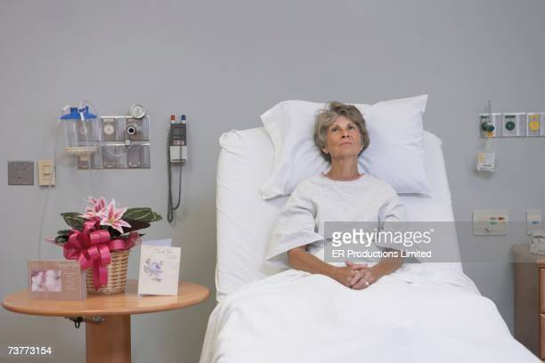 Senior woman sitting in hospital bed