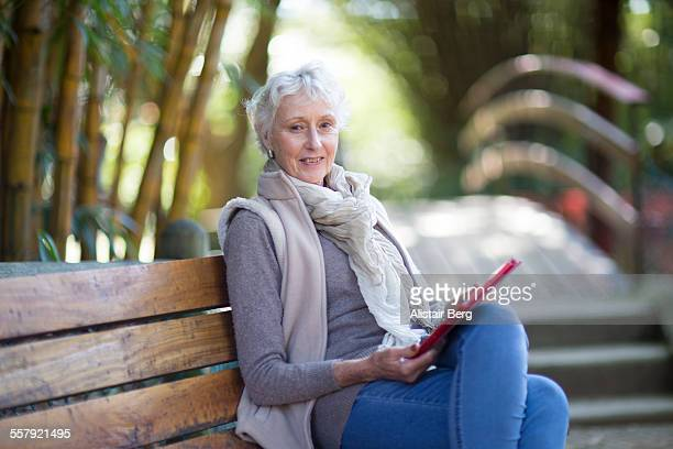 Senior woman sitting in park