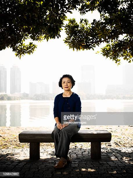 Senior Woman Sitting on a Park Bench