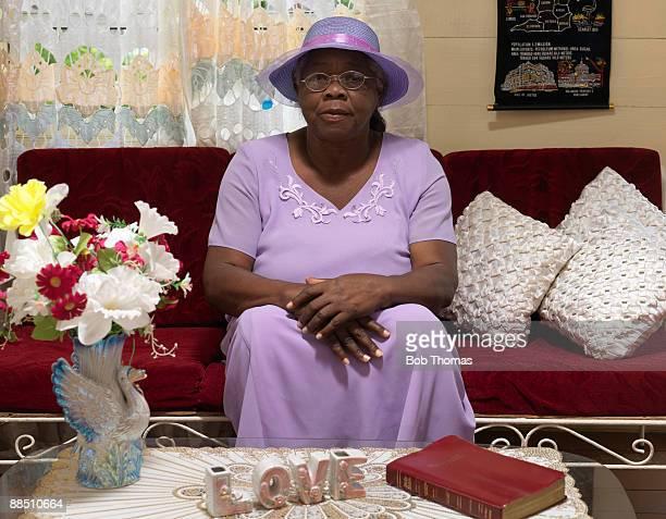 Senior woman sitting on sofa