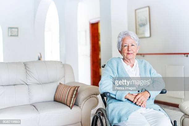Senior woman sitting on wheelchair in nursing home