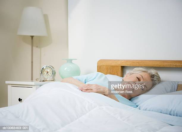 Senior woman sleeping in bed at home