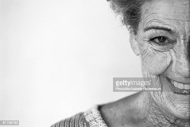 Senior woman smiling at camera, portrait, cropped