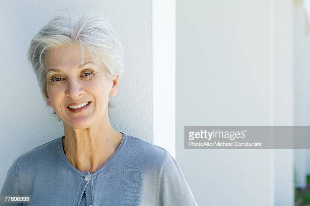 Senior woman smiling at camera, portrait