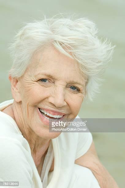 Senior woman, smiling at camera, portrait