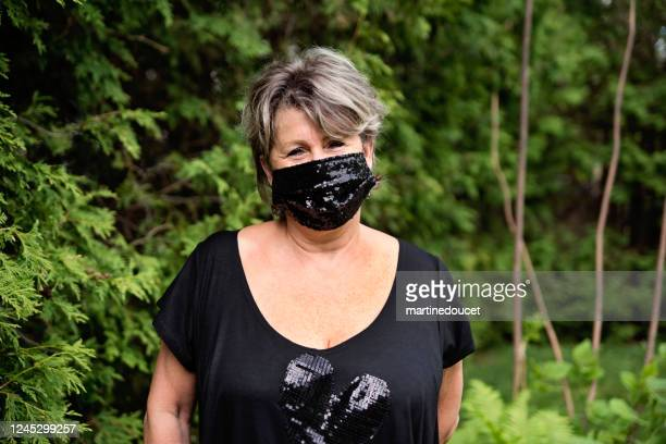 """senior woman smiling behing stylish protective mask. - """"martine doucet"""" or martinedoucet stock pictures, royalty-free photos & images"""