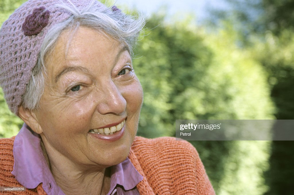 Senior woman smiling, close up : Stock Photo