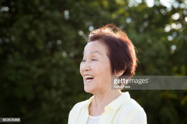 senior woman smiling in the park