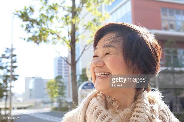 Senior woman smiling in town