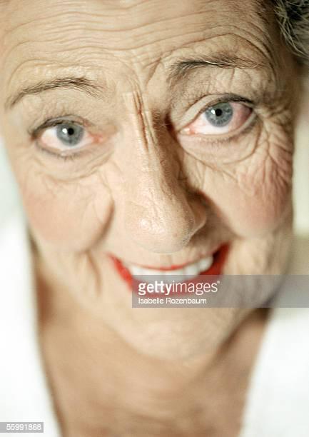 Senior woman smiling into camera, portrait.