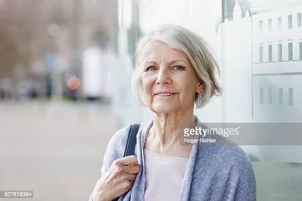 Senior woman smiling, Karlsruhe Region, Baden-Wurttemberg, Germany