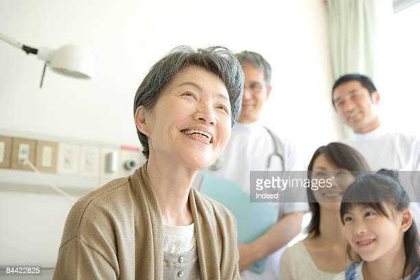 Senior woman smiling on bed