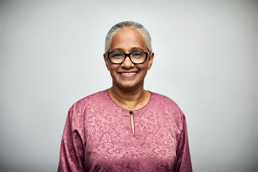 Senior woman smiling over white background - gettyimageskorea