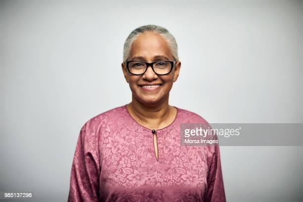 senior woman smiling over white background - malásia - fotografias e filmes do acervo