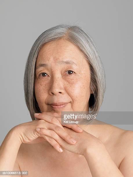 Senior woman smiling, portrait, close-up