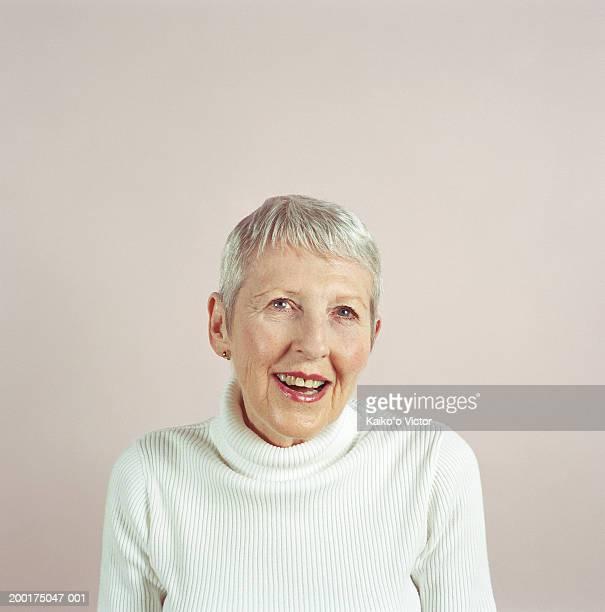 senior woman smiling, portrait - beige stock pictures, royalty-free photos & images
