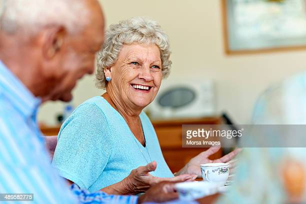 Senior woman spending leisure time with friends