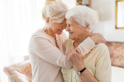 Senior woman spending quality time with her daughter 1145256211