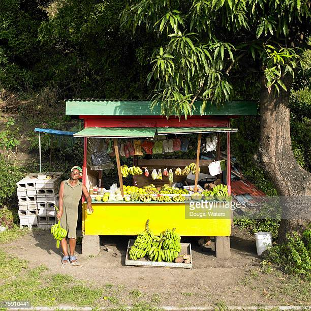 Senior woman standing by fruit stall