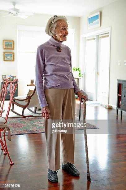 Senior woman standing in her living room