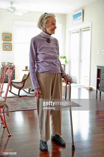 Senior woman standing in her living room