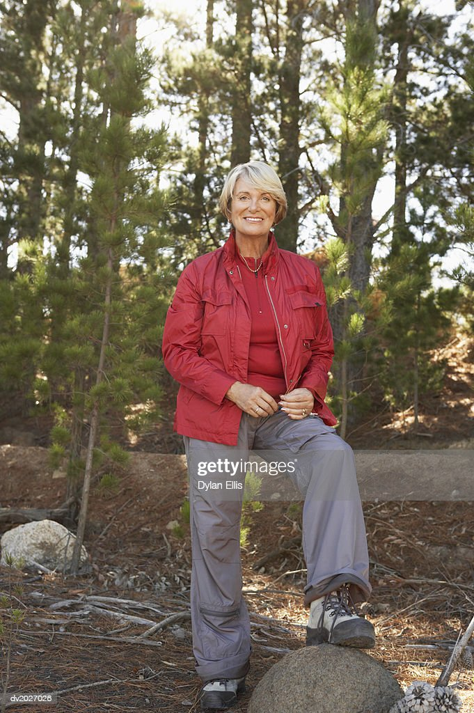 Senior Woman Standing in Woodland : Stock Photo