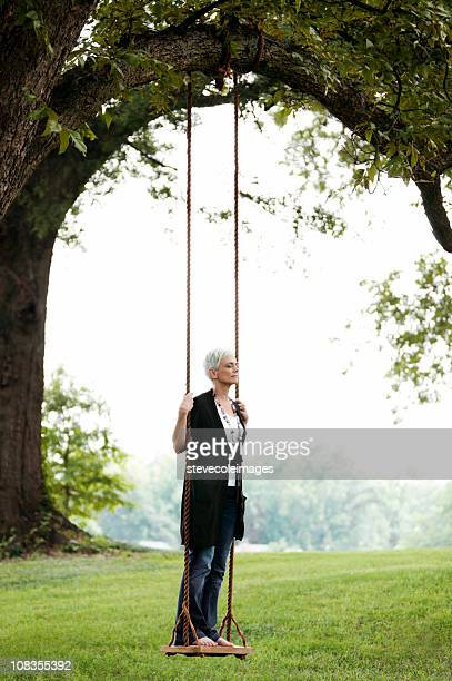 Senior Woman Standing on a Swing