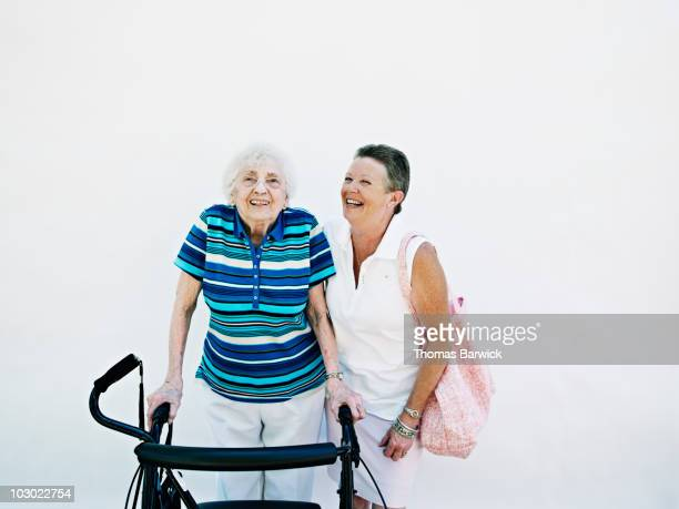 senior woman standing with mature woman - fragility stock pictures, royalty-free photos & images