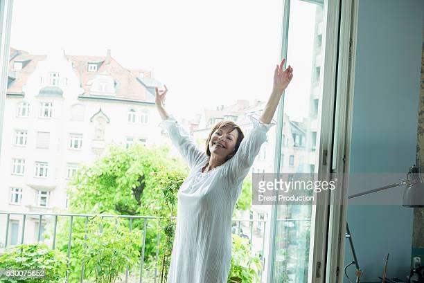 Senior woman stretching her body, smiling