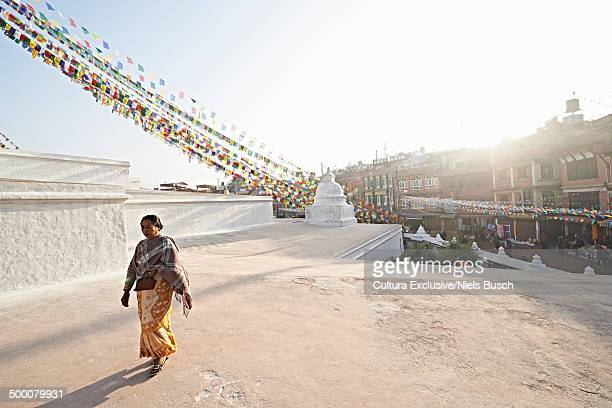Senior woman strolling by Boudhanath , Kathmandu, Nepal