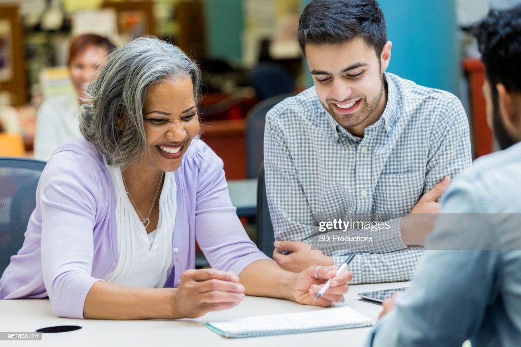 Senior woman studies with university classmates : Stock Photo