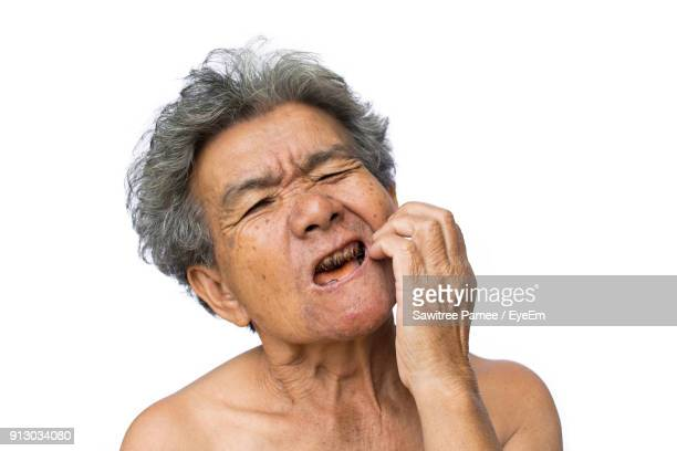 Senior Woman Suffering From Toothache Against White Background