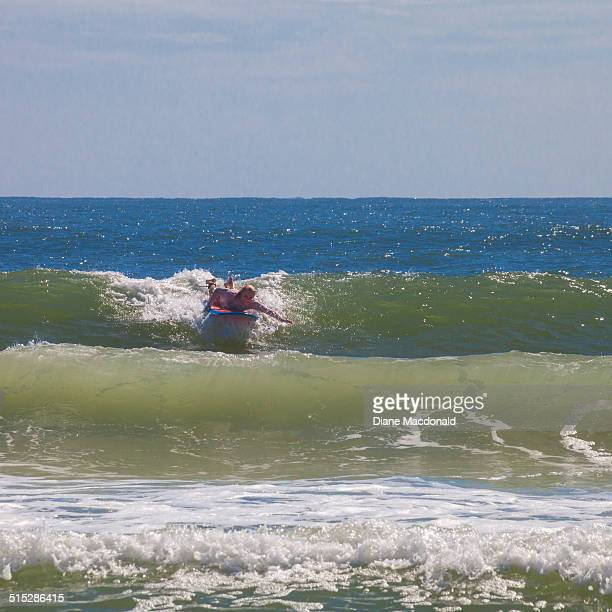 Senior woman surfer, Jacksonville Beach, Florida
