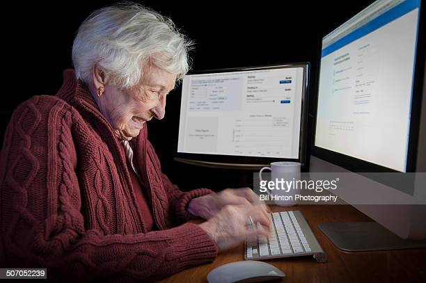 senior woman surfing internet - bill hinton stock pictures, royalty-free photos & images