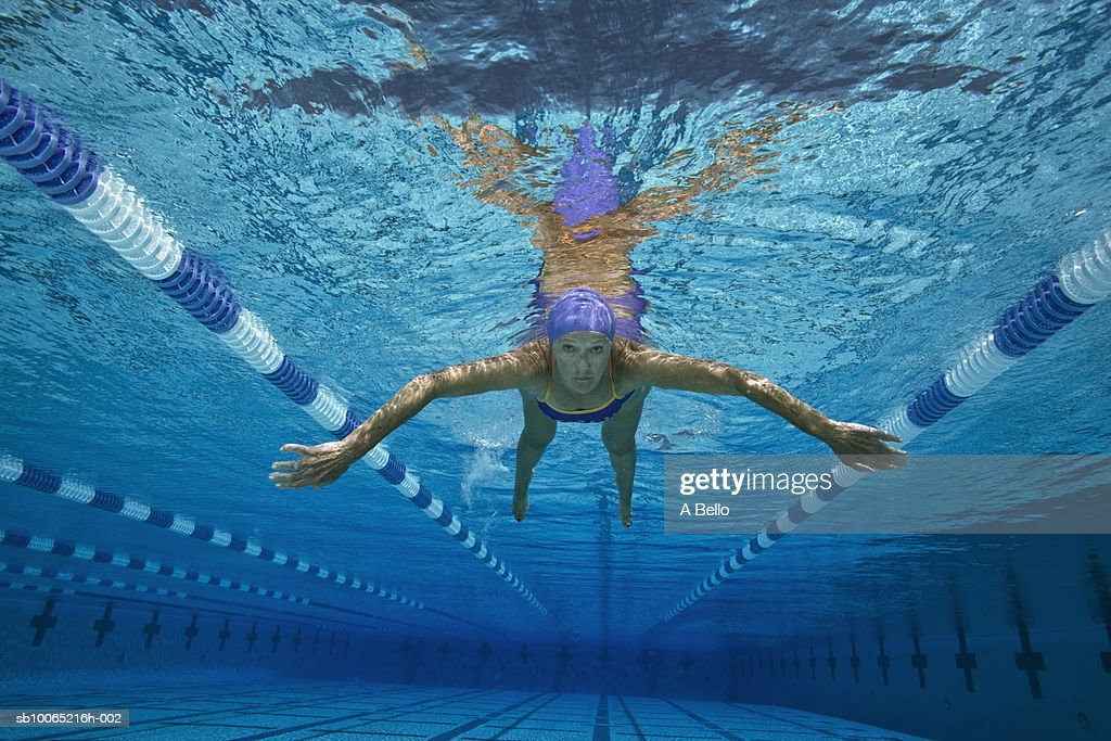 Senior Woman Swimming In Pool Underwater View Stock Photo
