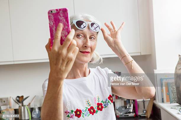 senior woman takes selfie - mature women stock pictures, royalty-free photos & images