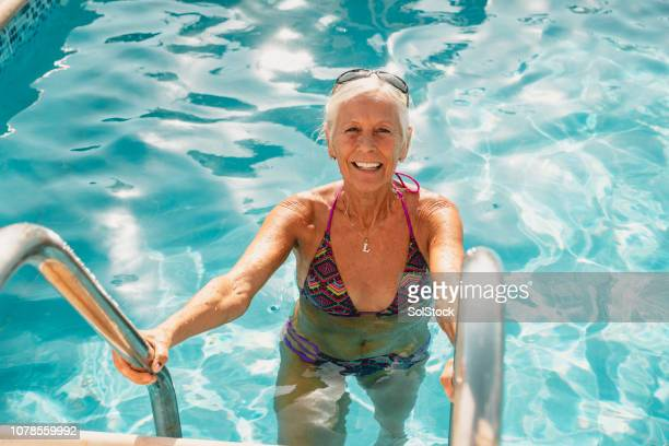 senior woman taking a swim - republic of cyprus stock pictures, royalty-free photos & images