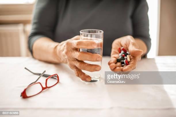 Senior Woman Taking Daily Medicine