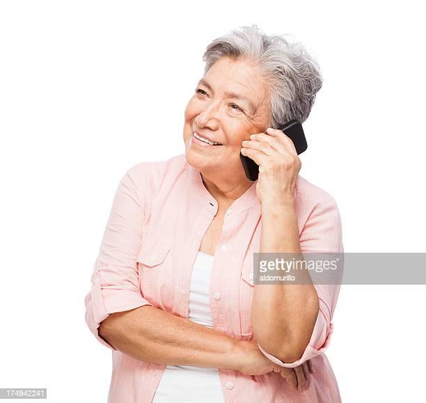 Senior woman talking on cellphone un