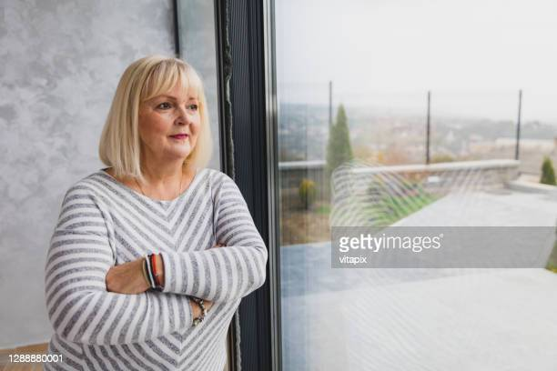 senior woman thinking - fat blonde women stock pictures, royalty-free photos & images