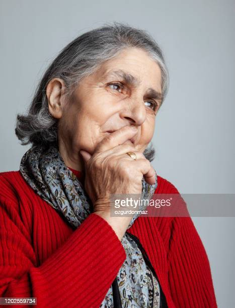 senior woman thinking portrait - hand on chin stock pictures, royalty-free photos & images