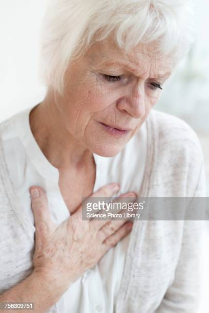 Senior woman touching chest