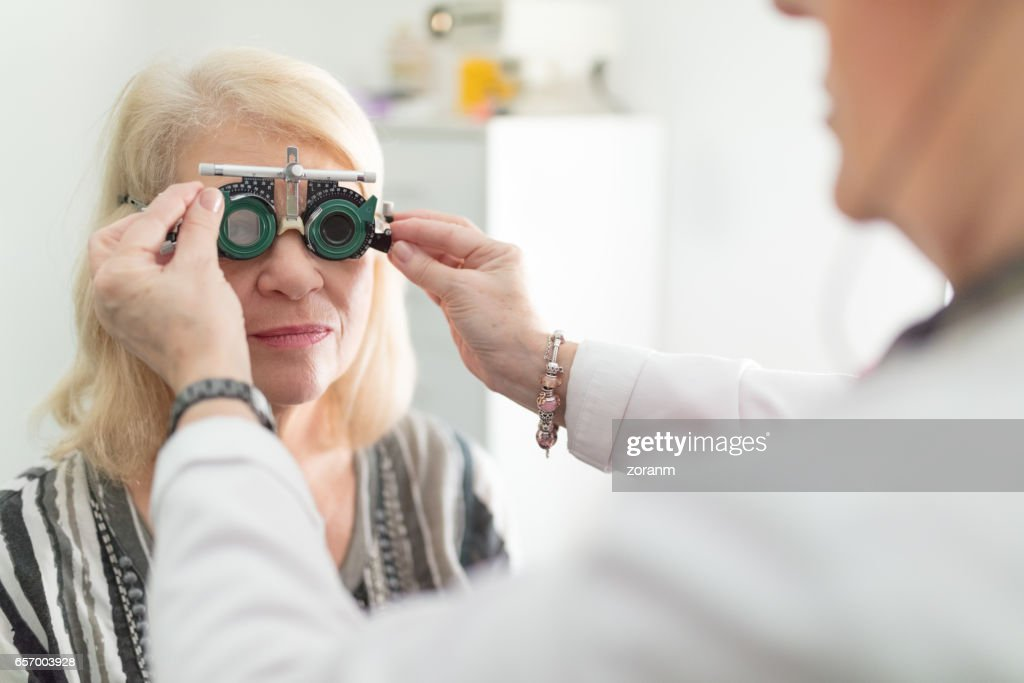 Senior Woman Trying Test Frames On Stock Photo | Getty Images