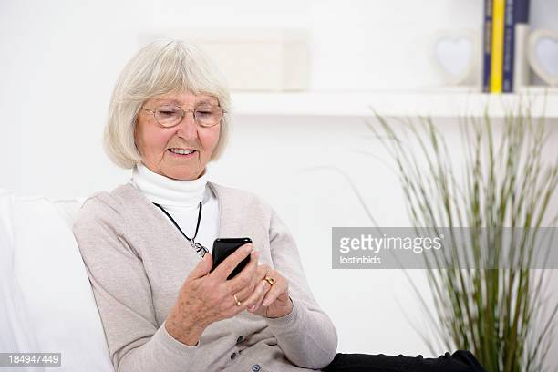 Senior Woman Using A Cell/ Mobile/ Smart Phone